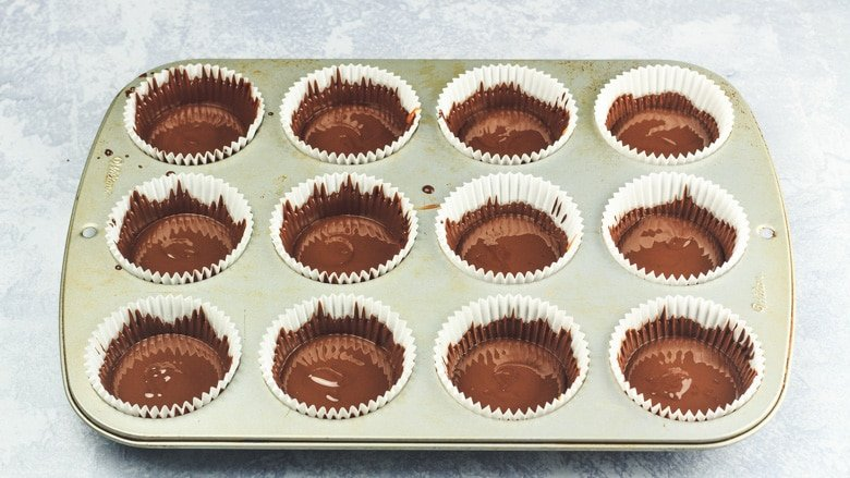 Salted Caramel Chocolate Cups in muffin cases ready to be chilled