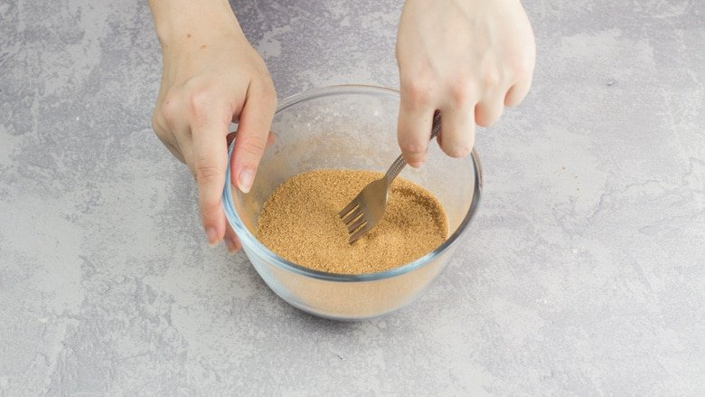 Whisking together sugar and cinnamon for Snickerdoodle Cookies