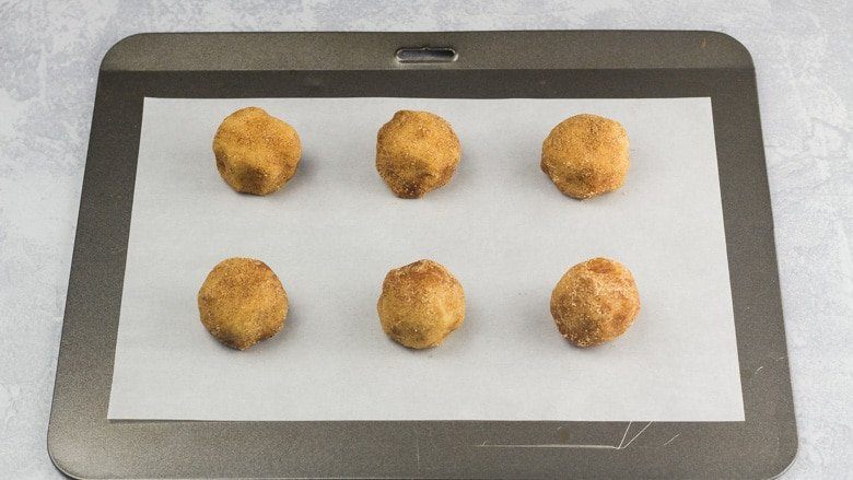 Snickerdoodle Cookie dough balls on a baking tray ready to be baked