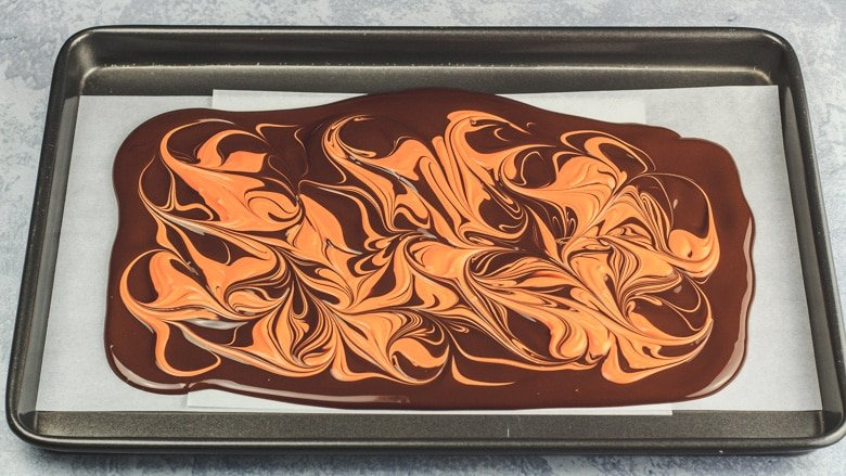 Chocolate orange bark prepared on baking tray.