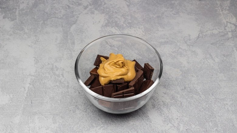 Chocolate and peanut butter in bowl ready to be melted.