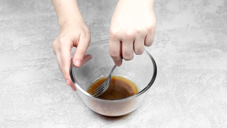 Whisking together butter, sugar, milk, and vanilla in small mixing bowl.